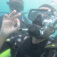 Srin underwater giving the 'ok' signal